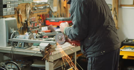 Angle-Grinder-Cutting-Metal-At-Workshop-39