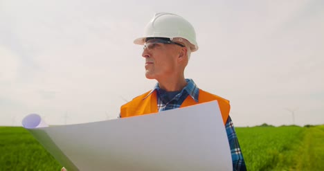 Engineer-Writing-On-Clipboard-While-Doing-Wind-Turbine-Inspection-12
