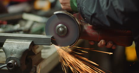 Steel-Industry-Man-Using-Angle-Grinder-Grinding-Metal-Object-