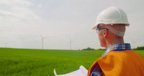 Engineer-Writing-On-Clipboard-While-Doing-Wind-Turbine-Inspection-4