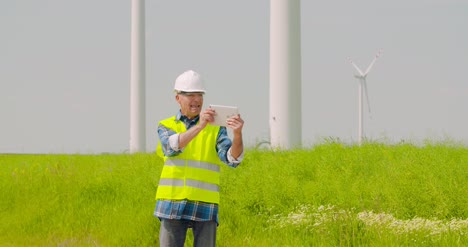 Male-Engineer-Video-Conferencing-Against-Windmills-7