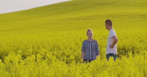 Farmers-Discussing-At-Rapeseed-Field-1