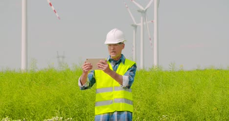 Male-Engineer-Video-Conferencing-Against-Windmills-8