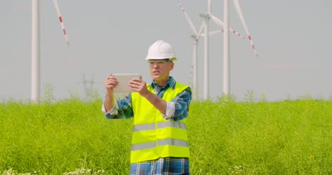 Male-Engineer-Video-Conferencing-Against-Windmills-9