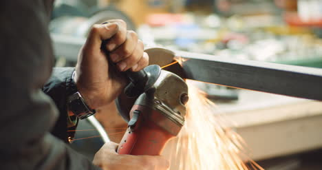 Steel-Industry-Man-Using-Angle-Grinder-Grinding-Metal-Object-At-Workshop-1