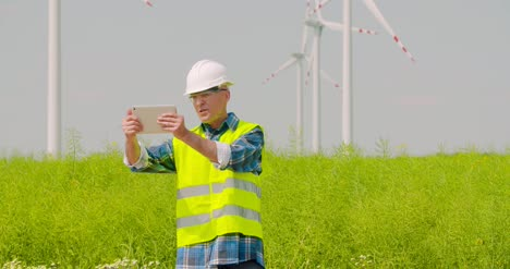 Male-Engineer-Video-Conferencing-Against-Windmills-10
