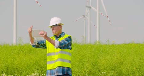 Male-Engineer-Video-Conferencing-Against-Windmills-11