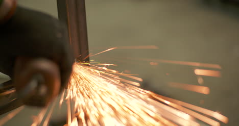 Steel-Industry-Man-Using-Angle-Grinder-Grinding-Metal-Object-3