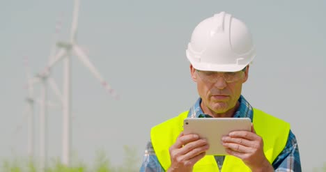 Male-Engineer-Video-Conferencing-Against-Windmills-12
