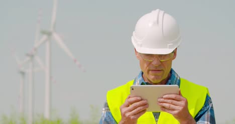 Male-Engineer-Video-Conferencing-Against-Windmills-13