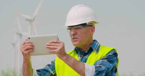 Male-Engineer-Video-Conferencing-Against-Windmills-2