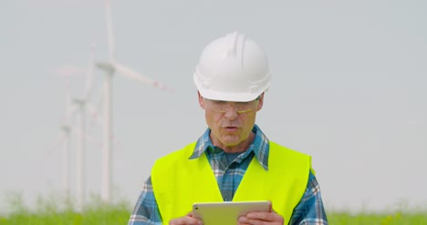 Male-Engineer-Video-Conferencing-Against-Windmills-4