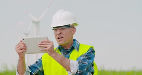 Male-Engineer-Video-Conferencing-Against-Windmills-5
