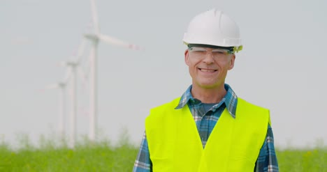 Technology-Successful-Engineer-Against-Windmills