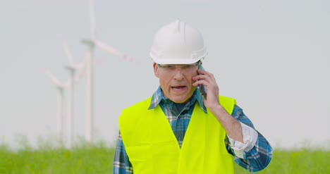 Frustrated-Male-Engineer-Talking-On-Phone-At-Farm-1