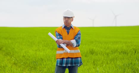 Male-Engineer-Working-While-Holding-Blueprint-19