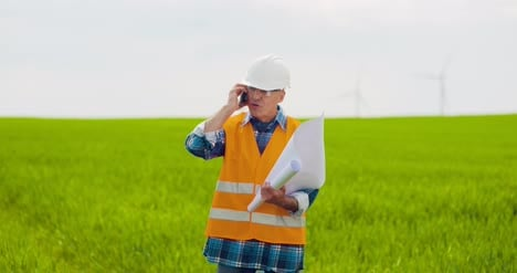 Angry-Engineer-Talking-On-Mobile-Phone-At-Farm