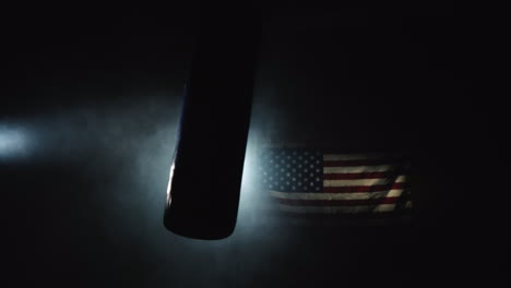 A-Boxing-Pear-Swings-In-The-Hall-In-The-Fog-And-Spotlight-In-The-Background-Of-The-US-Flag-4k-Video