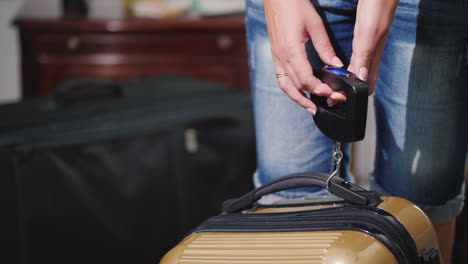 A-Woman-Understands-And-Weighs-Her-Baggage-Before-Leaving-The-Hotel