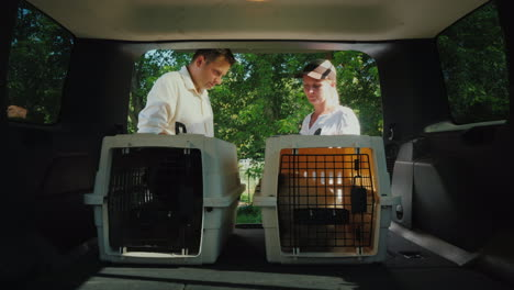 A-Man-Gets-A-Dog-In-A-Cage-Signs-For-Receipt-Pet-Delivery-Concept