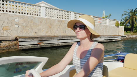 Young-Woman-Enjoying-A-Holiday-Resort-In-Europe-Floating-On-A-Boat-On-The-Channel-Empuriabrava-Spain