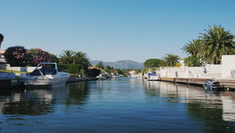 Canals-And-Houses-Of-Empuria-Brava-Empuriabrava-Is-Largest-Residential-Marina-In-Europe-In-The-Backg