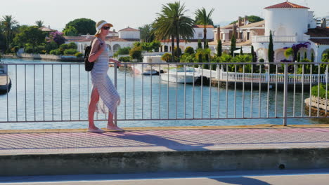 Young-Tourist-Woman-Walking-On-The-Bridge-Over-The-Canal-The-Area-Empuriabrava-Spain-The-Concept---A
