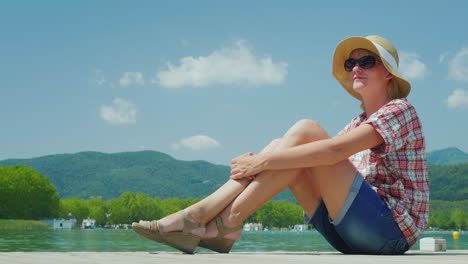 Holiday-Dreams-And-Privacy-Near-The-Picturesque-Lake-And-Mountains-In-Spain-A-Woman-Enjoying-The-Bea