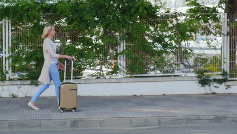 Young-Woman-With-Suitcase-On-The-Road-Wheels-Are-On-The-Pavement-Concept---Arrival-To-The-Hotel-Or-V