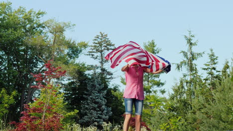 Emotions-With-Usa-Flag---Young-Woman-Jumping-Holding-A-Flag-In-Her-Hands-Independence-Day-And-A-Trip