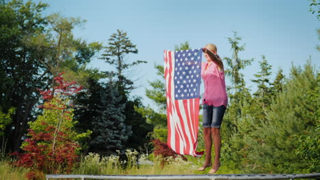 Sporty-Woman-With-Usa-Flag-Jumping-On-Trampoline-Slow-Motion-Video