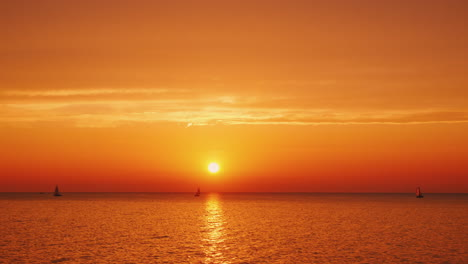 Beautiful-Sunset-Over-Lake-Ontario-In-The-Usa-Yachts-Are-Visible-In-The-Distance
