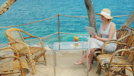 Holidays-On-A-Tropical-Resort-Always-Connected-Woman-Talking-With-The-Tablet