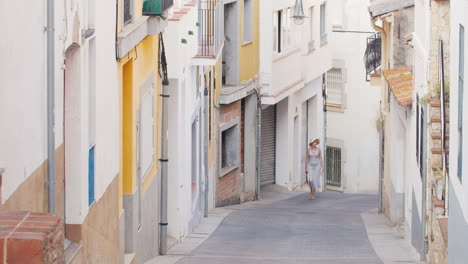 Woman-Tourist-Is-Vverhpo-Narrow-Street-In-The-Old-Quarter-Of-The-Old-City-Lloret-De-Mar-Spain-Touris
