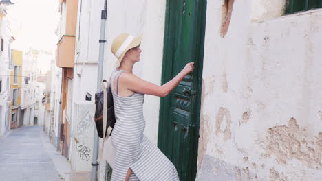 Woman-Tourist-Hand-Knocking-On-The-Closed-Door-In-The-Old-Town-Area-Of-The-Mediterranean-She-Nobody-