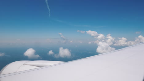 View-From-The-Window-Of-The-Airliner-On-The-Wing-Of-The-Aircraft-With-A-Large-Engine-And-Beautiful-C