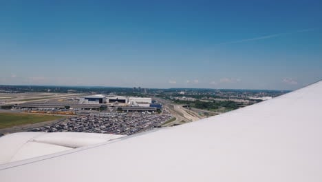 The-View-From-The-Window-Of-The-Plane-The-Airliner-Starts-Landing