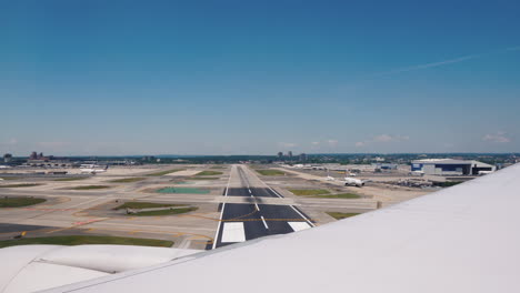View-From-The-Window-Of-An-Airplane-That-Lands-At-A-Large-Airport