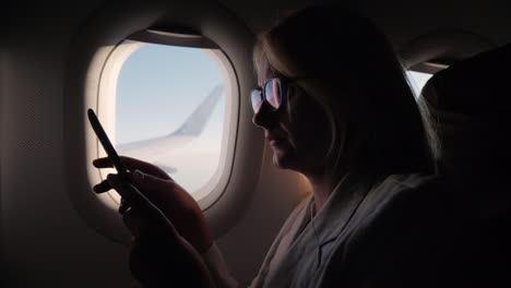 Young-Woman-Reads-E-Book-In-Flight