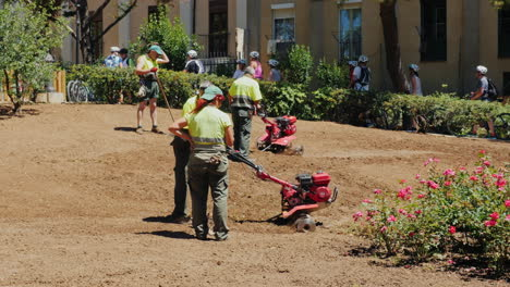 Barcelona-Spain---June-20-2016-Municipal-Gardeners-Working-In-The-Flowerbed-Cultivate-The-Land-Culti