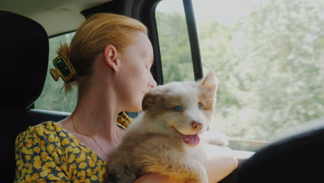 A-Woman-With-A-Pet-Travels-In-A-Car-Looking-Out-The-Window-Together