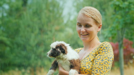 Emotional-Woman-With-A-Puppy-In-Her-Arms-In-The-Pouring-Summer-Rain-Unforgettable-Moments-Of-Life
