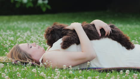 Pregnant-Woman-Playing-With-Her-Puppy