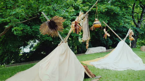 Two-Traditional-Indians-Tents-Are-Wigwams-Camp-In-The-Forest