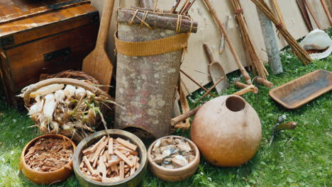 Weapons-Dishes-And-Other-Household-Items-Of-Indians-Near-The-Wigwam