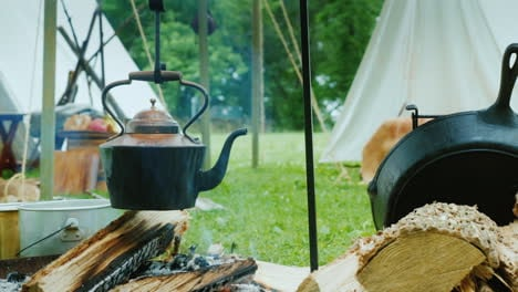 The-Kettle-Boils-In-Native-American-Camp-In-The-Forest-Food-Is-Being-Prepared-In-The-Foreground-Trad