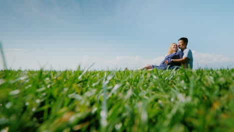 Multi-Ethnic-Couple-Resting-On-The-Green-Grass-Admiring-The-Beautiful-Nature