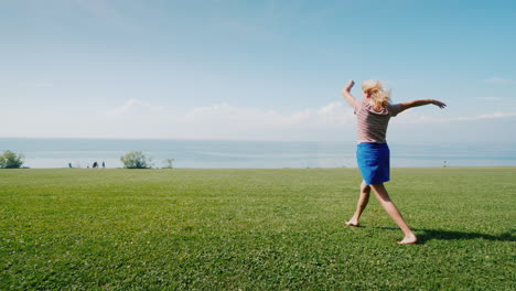 Cheerful-Active-Woman-Is-Walking-On-A-Green-Meadow-Youth-And-Activity