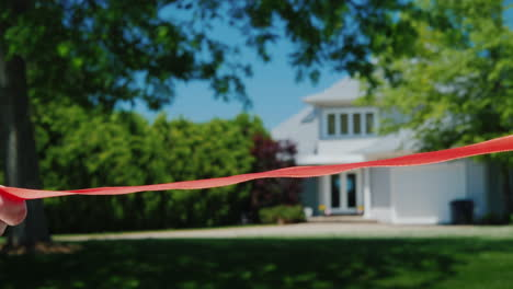 Cut-A-Traditional-Red-Ribbon-At-The-Grand-Opening-And-Housewarming-In-A-New-Home