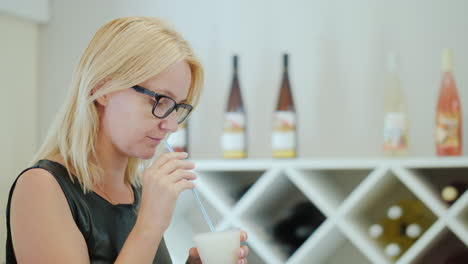 Woman-Drinks-A-Cold-Drink-From-Ice-And-Wine-From-A-Straw
